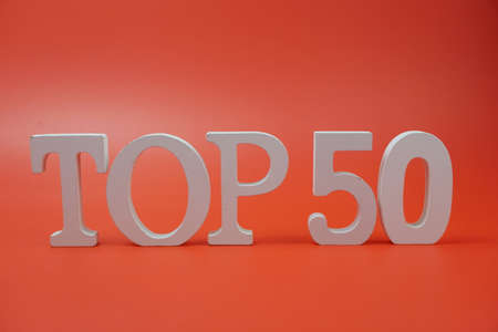 Top 50 word alphabet letters on red background Фото со стока