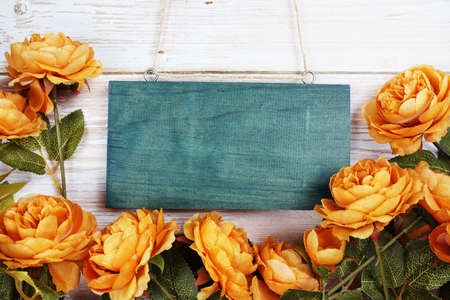Top view Blooming Flowers frame with copy space on wooden background