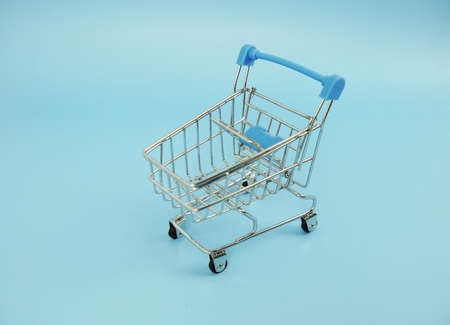 Mini trolley cart with space copy on blue background