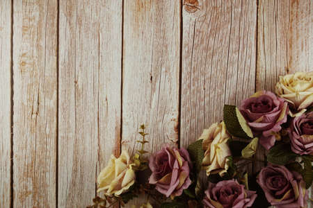 Roses flower bouquet with space copy on wooden background