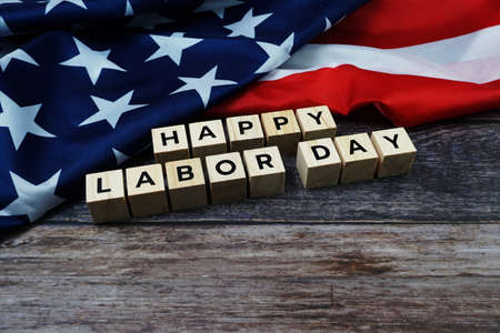 Happy Labor Day Word alphabet letters with USA flag on wooden background