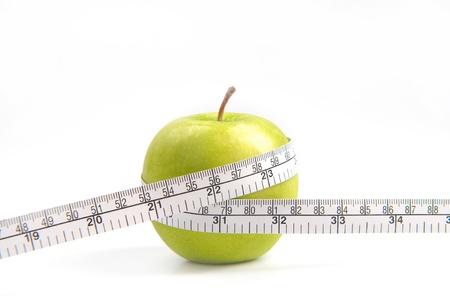 metro medir: Manzanas verdes miden el medidor, manzanas de deportes Foto de archivo