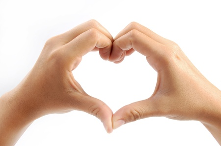 idiomas: manos que forman un coraz�n en el fondo blanco Foto de archivo