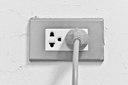Double electrical power socket and single plug switched on, white background Stock Photo - 10713521
