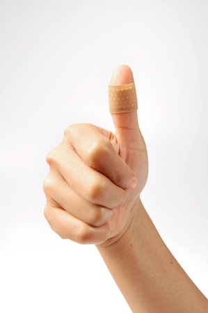 wound care: thumbs up with bandage on white background