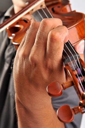Violin is in the hands of professional violinist. photo
