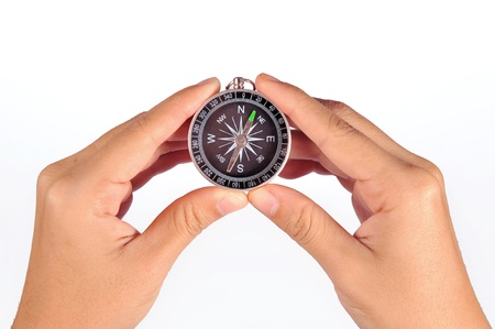 Hand holding the black compass photo