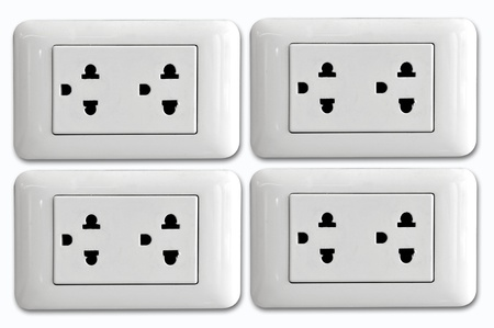 Double electrical power socket and single plug switched on, white background. photo