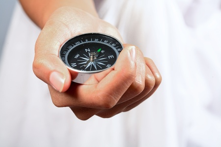 Hand holding the black compass Stock Photo - 10758541