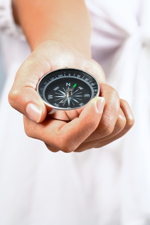 Hand holding the black compass Stock Photo - 10773556