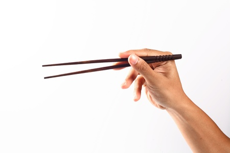 chinese chopsticks in hand