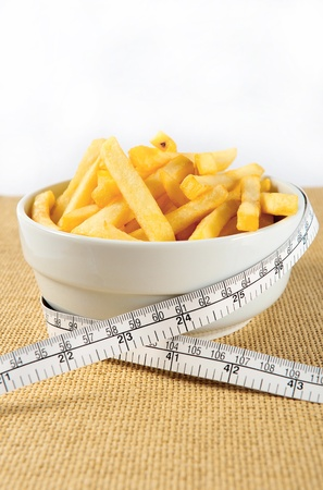 French fries and white measuring tape photo