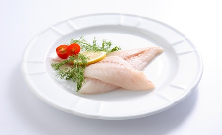 Fresh fish close up on a white plate Stock Photo