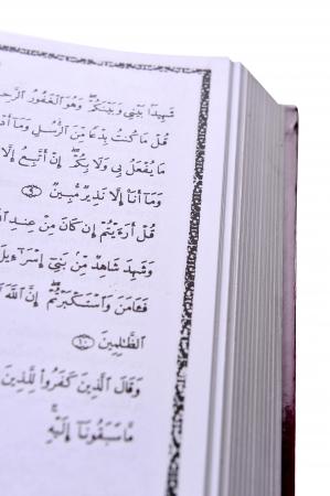 Holy islamic book Koran opened and isolated photo