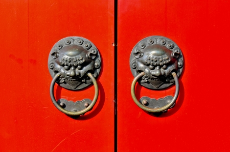 door handles: Red chinese door with a lion dragon head  Concept  Chinese New Year celebration