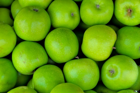 Lots of Green ripe apples background  Stock Photo