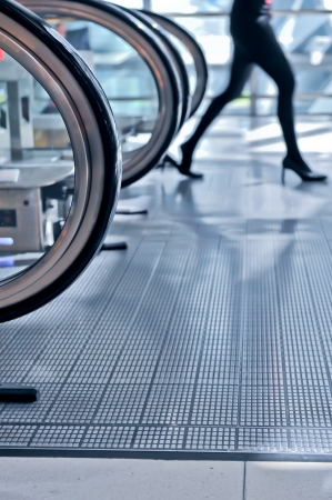 people move in glass corridor in airport Stock Photo - 15141922