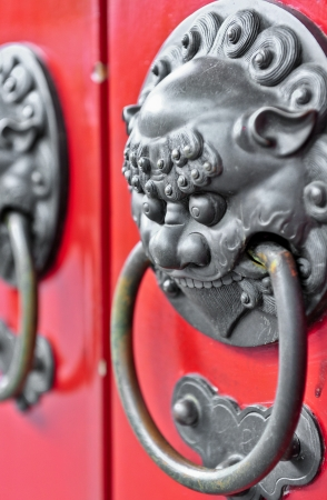 Red chinese door with a lion dragon head  Concept  Chinese New Year celebration  photo