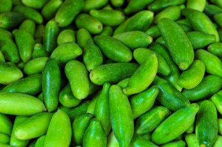 bunched: Cucumbers bunched together For Sale At Market good as a background Stock Photo