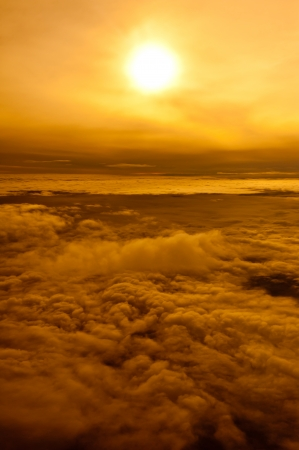 A view on the clouds at sunset from a plane