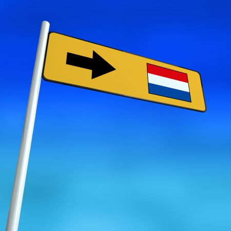 Sign Pointing in direction of the Netherlands Stock Photo