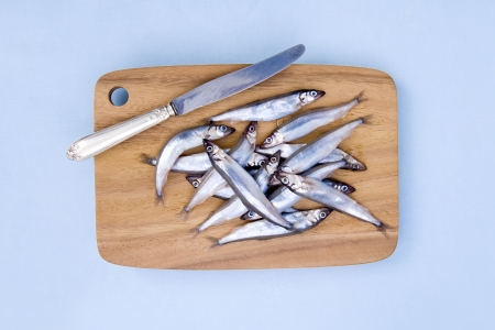 Fresh fishes on wooden cutting board  photo