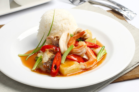 quid: Spicy seafood with rice