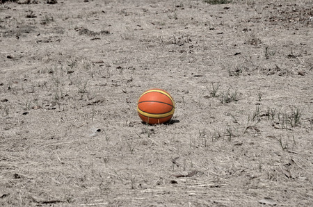 basketball resting on the ground. Stock Photo