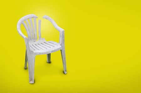 plastic chair on yellow background.