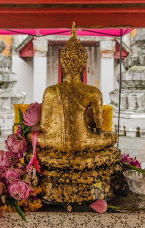 Lotus in hand image of buddha - back view photo
