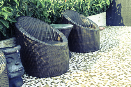 Outdoor patio with empty chair and table - Vintage Light Filter Stock Photo