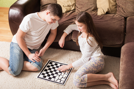 draughts: children with draughts at home
