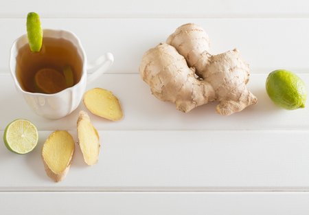 Ginger tea with lime in a white cup Stock Photo