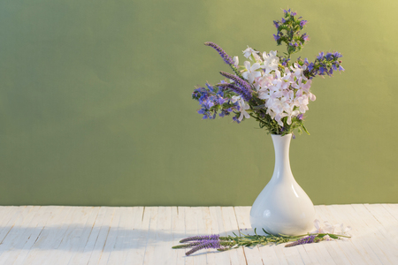 flowers in a vase on green background Stock Photo