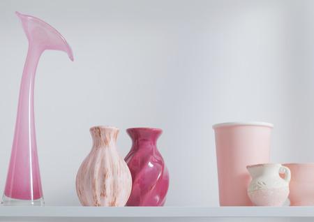 shelf: pink vases on white shelf Stock Photo