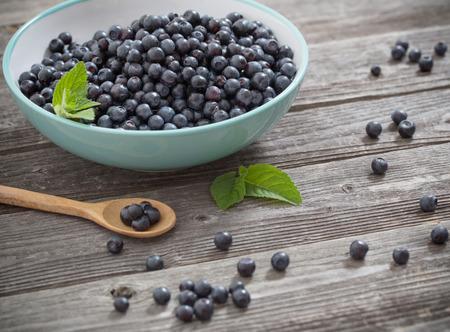 lemon balm: blueberries on old wooden background Stock Photo