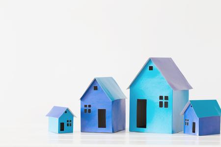 blue paper houses on white background Imagens