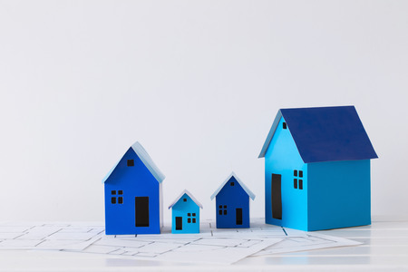 blue paper houses on wooden table