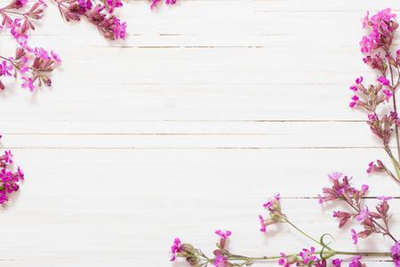 wild silky white: pink flowers on white wooden background