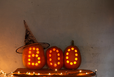 Halloween pumpkins on background old wal Stock Photo