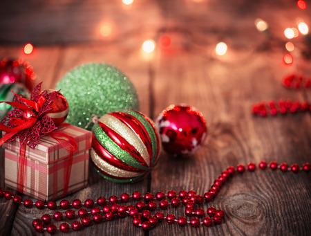 Christmas balls and Christmas gift on  wooden background