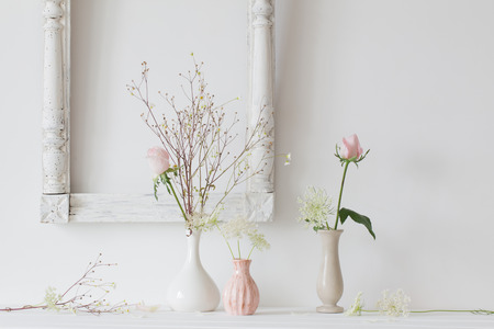 flowers in a vase on white background