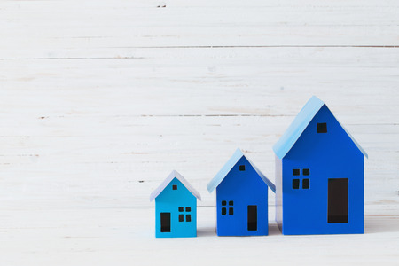 blue paper houses on white background Stock Photo