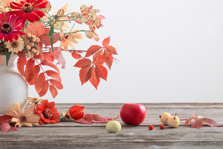 Still life with a autumn flowers and leaves Stock Photo