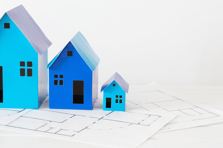 midget: blue paper houses on wooden table