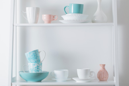 Clean dishes on wooden shelf