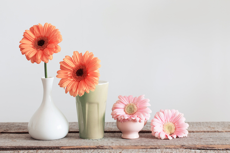 home accent: Gerbera in vase on old wooden table