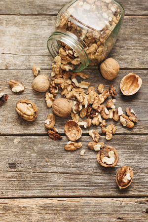 nutshells: walnuts on rustic old wooden table