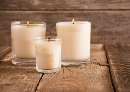 scented candles on old wooden background Banco de Imagens