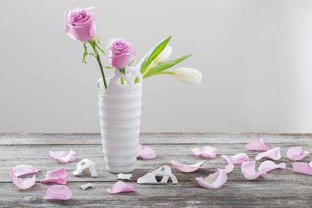 Pink Roses In Broken Vase On Old Wooden Table Stock Photo Picture